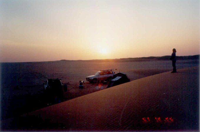 Camp at sunset time in the Dahnā' dunes