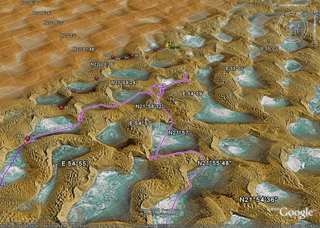 Google Earth 3D view with planned waypoints (red) and actual tracks(purple). Closest tracks are 2700 m SSW of the Confluence at 21.97668°N 54.99182°E. Better route for next time is to follow the red planned waypoints to the North.