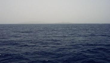 #1: View looking SE at 25N 37E with reef break waves and distant Hasāniyy and Libāna Islands