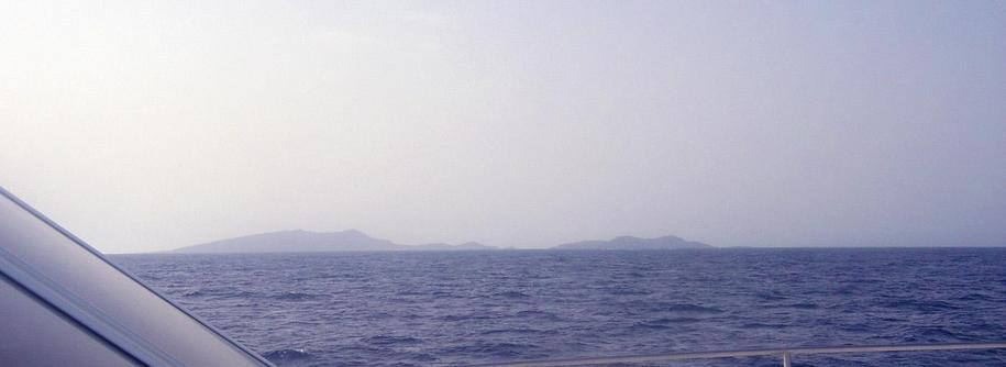 View looking SE at 25N 37E with Libāna Island (foreground right) and al-Hasāniyy Island in the distance.  Photo take from the bow of Dream Voyager.