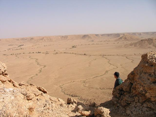 The wide wādī that we walked across. Note the cars on top of the escarpment in the top left corner.