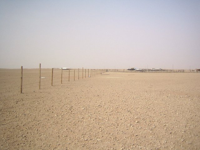 North - Fenced in with settlements in the distance