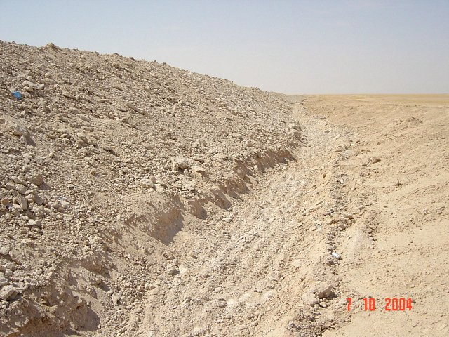 The ditch and the sand wall