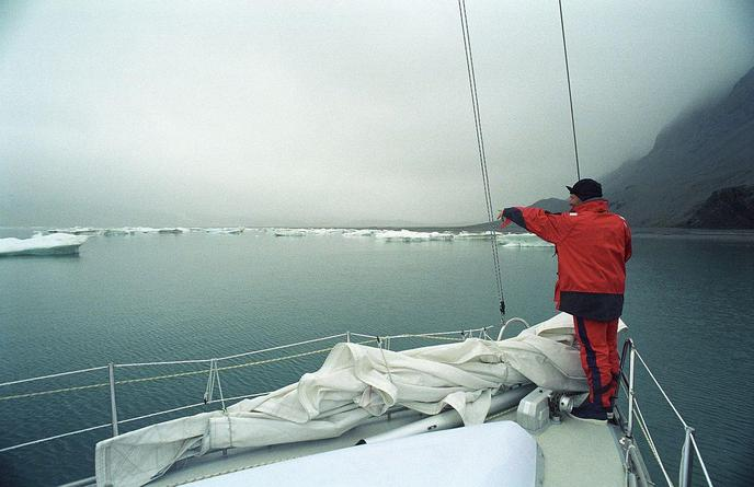 Imram, arctic sailboat, negotiating icebergs in Svalbard