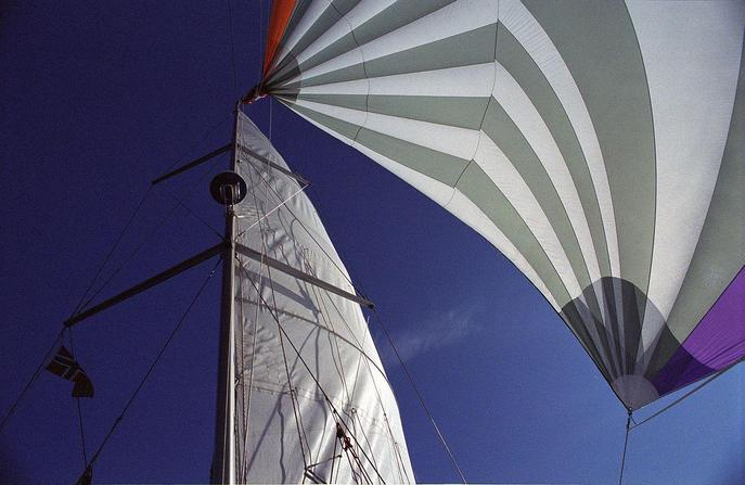 With the spinnaker up, sailing along the 80N