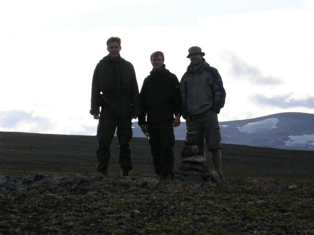 Confluence visitors, with cairn