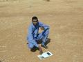 #7: My colleague Awadullah holding the map and GPS