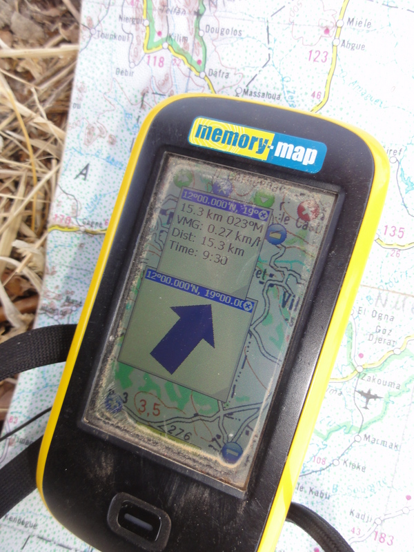 GPS receiver screen and road map at closest point near the village of Kilim