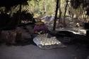 #4: Inside sugar making hut; note big pan to right and fire pits to left