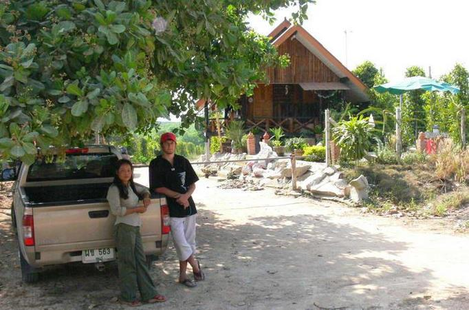 Eddie and Wattanah at the entrance to the far, with pretty farm house in back.  95 meters to go
