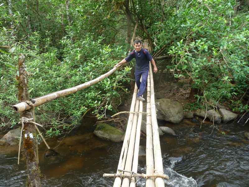 Dit Ley crossing one of the bamboo bridges near the start of our journey.