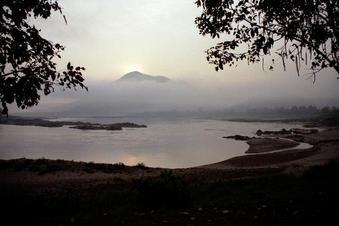 #1: Sun rising over moutain; Mekong rapids in foreground
