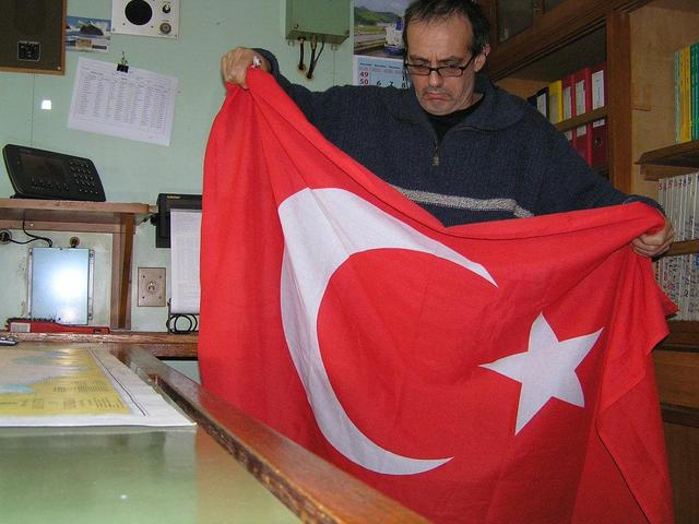 Captain Peter is folding up the Turkish flag