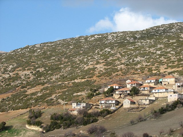 "View of a small part of the ""upper"" Yeşilköy with the farmhouse near the centre and the Confluence hill in the background"