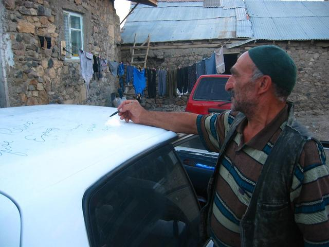 Farmer signing our car