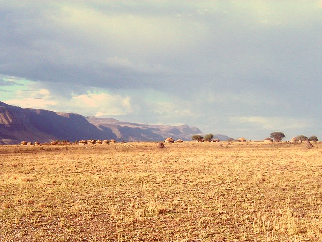 Looking North along the Escarpment with a Maasai village in the foreground