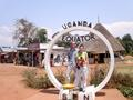 #6: Laurel and Brian crossing the equator on the main road from Kampala (note funnel in foreground).