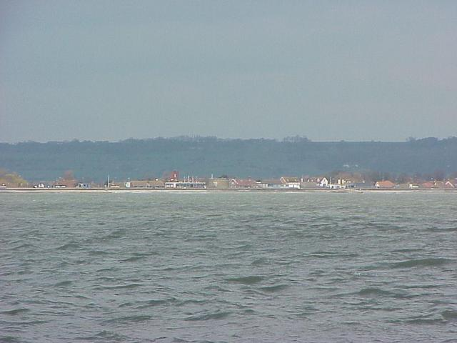 View to the north at the south coast of England from the confluence point in the English Channel.