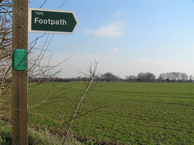"Footpath sign at the start of our walk to the confluence.  The confluence is below and to the right of the ""h"" in ""footpath"", where the right-most branch points skyward."