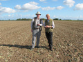 #7: Alan and Gerald - two men out standing in their field.