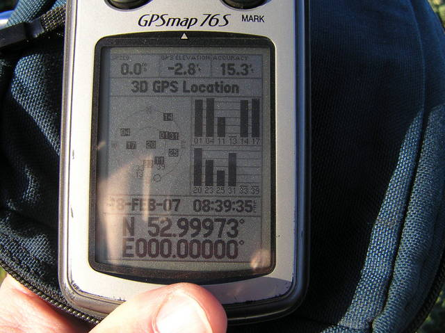 On the Prime Meridian:  GPS receiver at the edge of the field, near the confluence.