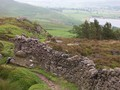 #5: rock fence on moor, with reservoir in background