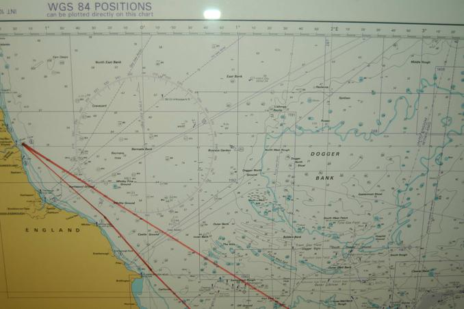 sea chart displayed onboard the ferry, red lines showing the ferry´s route