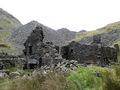 #7: Quarrymen's row house ruins with some of the many slate waste heaps in the background.