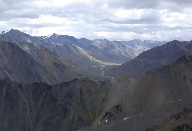 View East from confluence ridge to Sheenjek River, our camp at fork