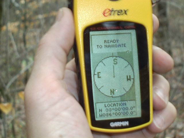My GPS with the woods in the background