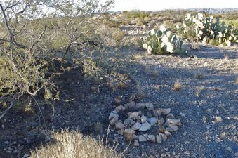 #1: The confluence point lies in rocky desert terrain (a rock circle left by previous visitors marks the point)