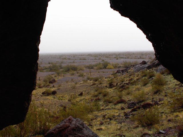 Hiking in.  Watching the rain from inside a small lava cave
