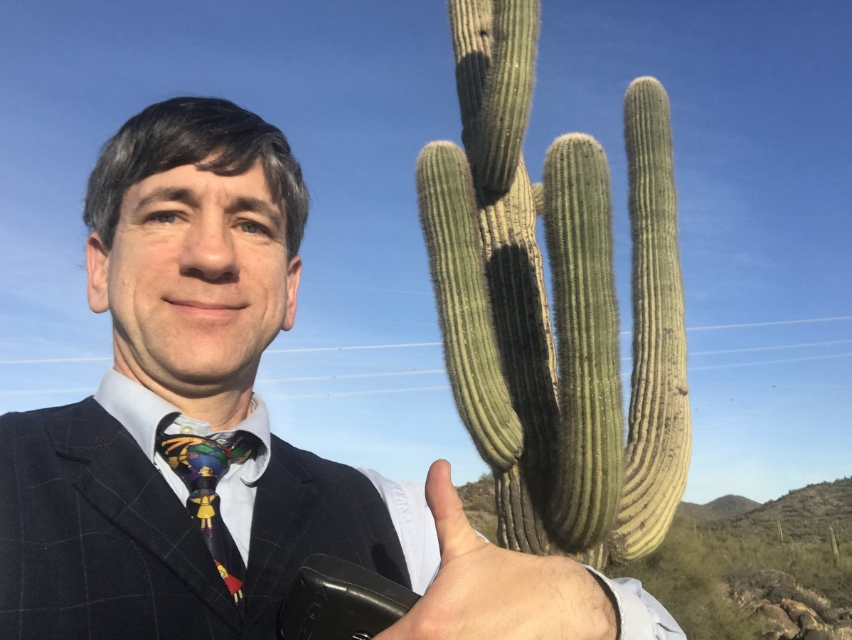 Joseph Kerski near the confluence point near a quintessential Arizona plant form--the Saguaro.
