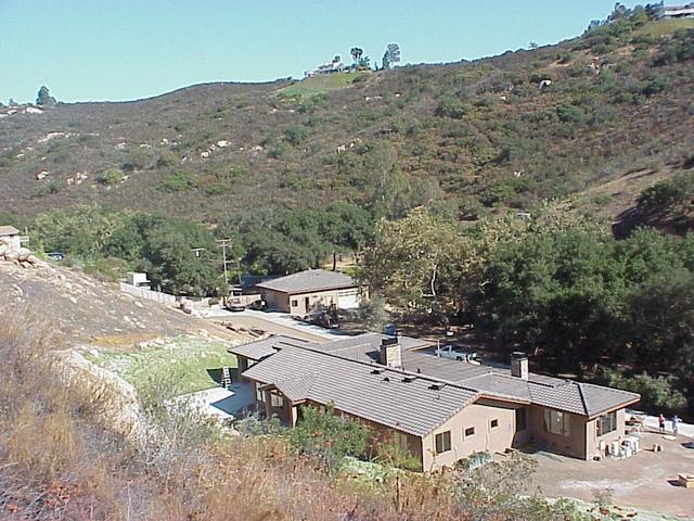 View to the east-southeast from the confluence, showing the new home and arroyo.