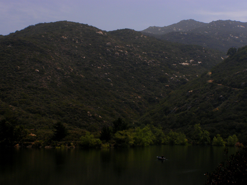 Lake Poway.  The trail leading to the confluence is snaking up the hill to the right.
