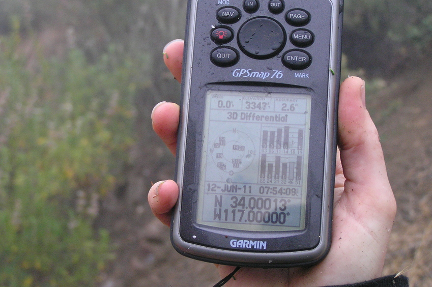 Wet GPS receiver at the confluence site.