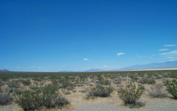 Looking north, across the dry lake on the right you can partially make out the town of Pahrump