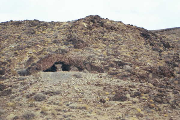A strange-looking cave (or perhaps an old mine shaft?) visible near the confluence point
