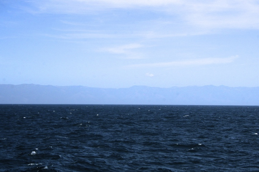 Looking east towards Lopez Point.  The confluence is 21 NM @ 266 degrees true from Lopez Point.   The highest mountain on the horizon, is Cone Peak, at 5,155 ft.