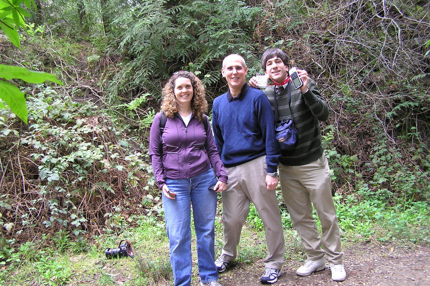 Lorrie Conklin, Greg Conklin, and Joseph Kerski at the confluence point.