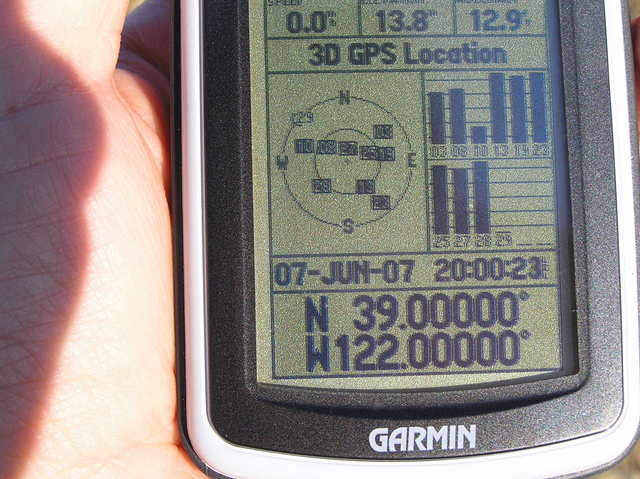 GPS reading at the confluence.  The GPS time is set for 1 hour later than the local time.