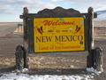 #7: Looking south at the New Mexico welcome sign, and the actual state line sign behind it