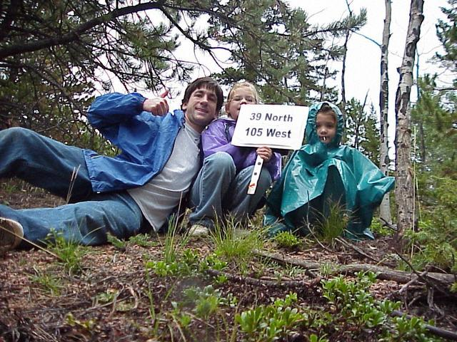 Joseph, Emily, and Lilia Kerski arrive at confluence site as light rain falls.