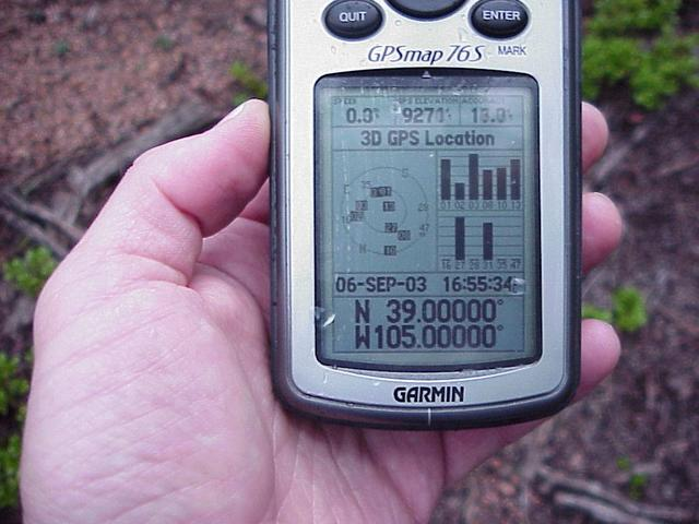 Raindrops on GPS unit as it records the confluence's location.