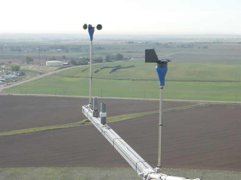 Cup anemometer and wind vane mounted on the BAO tower at 100 m above ground level.  The confluence point is just out there about three miles from the tower!