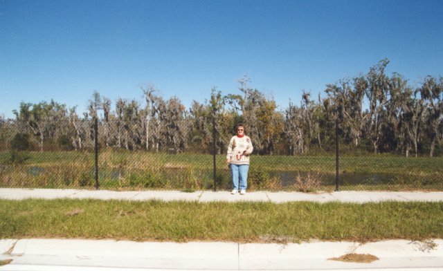 Mom in front of the confluence, facing south.