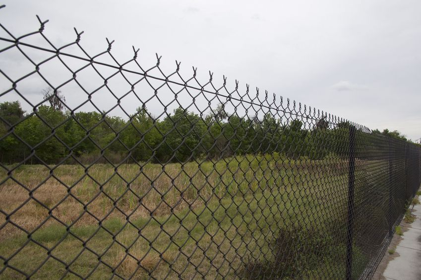 View East from behind the chain-link fence, 81 feet from the confluence point, which lies in the left-hand side of this photo