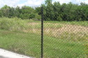 #8: View of the fence and the confluence beyond, looking northwest.