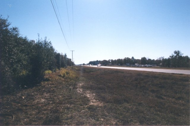Looking south along US-27. The confluence is in the woods, to the left.