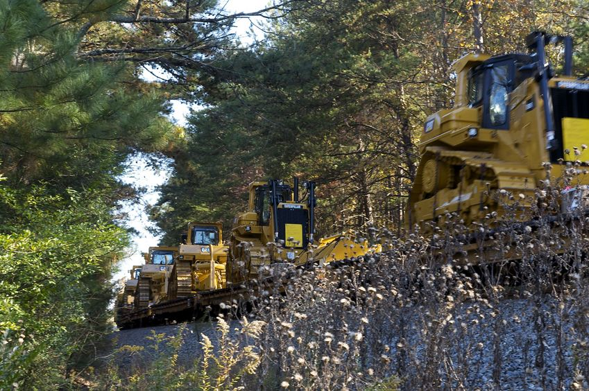 A train - carrying new Caterpillar vehicles - passes between the road and the confluence point.  (It's nice to see that manufacturing in the U.S. is still alive!)
